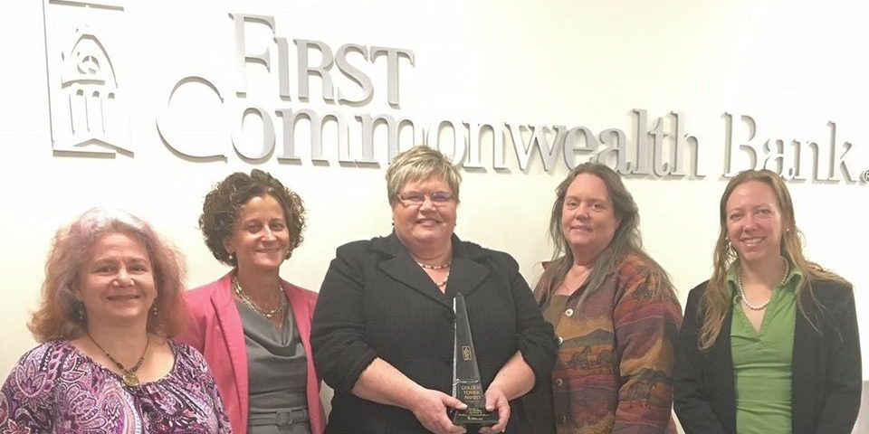 Elevate Northland Co-Founders receiving an award from First Commonwealth Bank
